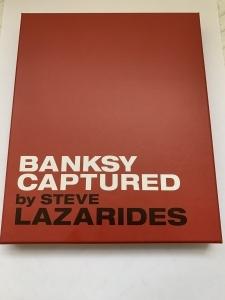 """アーティスト・バンクシー本人をとらえた作品集が発売。""""BANKSY CAPTURED"""" by STEVE LAZARIDES"""