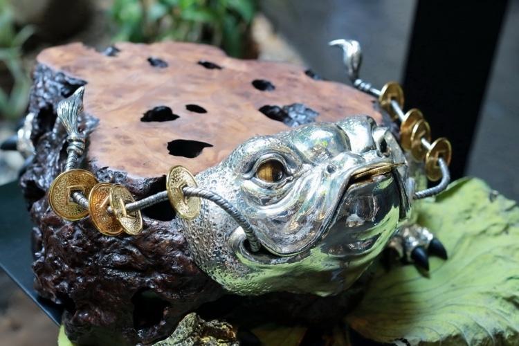 adf-web-magazine-5. wooden lucky toad sculpturetable