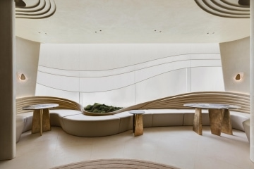 adf-web-magazine-dezeen-awards-2020-the-series-of -furniture-blinds-and-sculpted-ceiling-creates-contour-lines-that-suggest-raked-gravel-patterns-of-a-sand-garden